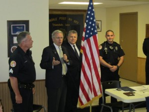 John takes part in an awards ceremony at the Urbandale Police Department